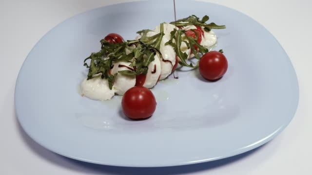 Mozzarella cheese. Dish with mozzarella cheese and balsamic dressing.