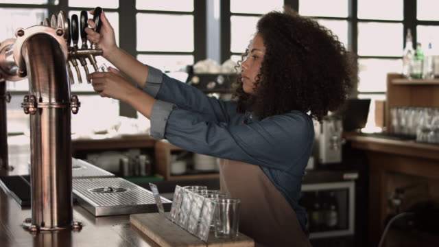 MS_Cool woman pouring beer at bar & microbrewery video