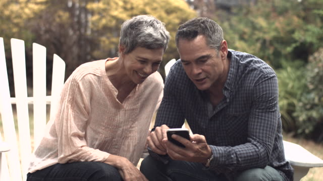 MS_Senior couple looking at smartphone together in garden video