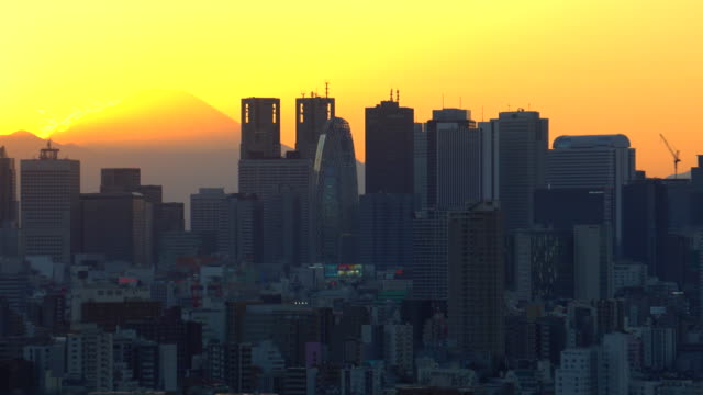 Mt.Fuji with the city building before sunset Mt.Fuji with the city building before sunset office park stock videos & royalty-free footage
