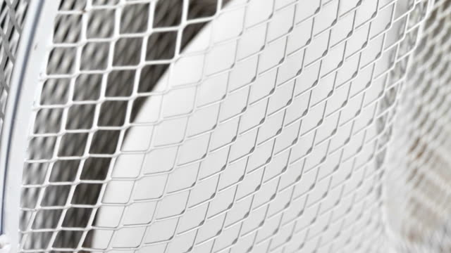 A much closer look of the cover of the white electric fan