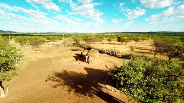 HELI Mud Huts In The Himba Village HD1080p: AERIAL HELI shot of mud huts in the Himba village. Northern Namibia, Namibia. Africa. minority groups stock videos & royalty-free footage