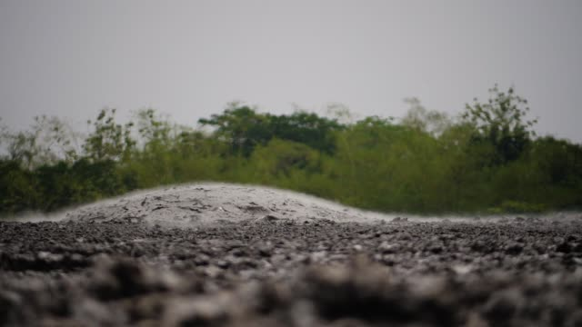 Mud volcano Bledug Kuwu, Indonesia mud volcano with bursting bubble bledug kuwu. volcanic plateau with geothermal activity and geysers, slow motion Indonesia java. volcanic landscape mud stock videos & royalty-free footage