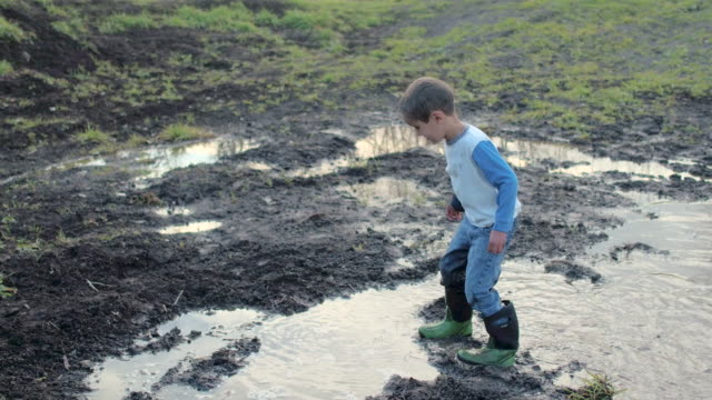 muddy puddles - children video stock e b–roll