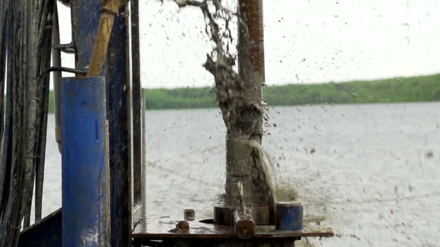 muddy water jets from drilling pipe slow motion video