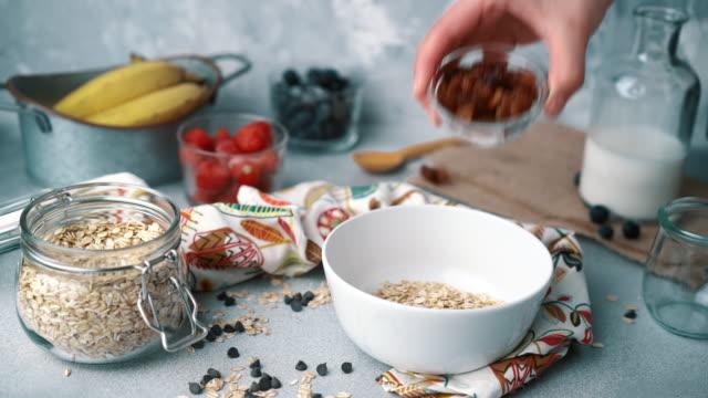 Muesli Bowl With Fresh Blueberries, Strawberries and Milk: Adding Raisins