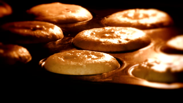 Muffins cooking golden time lapse, shallow depth of field video