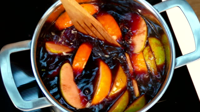 Mulled wine is boiling on the stove video
