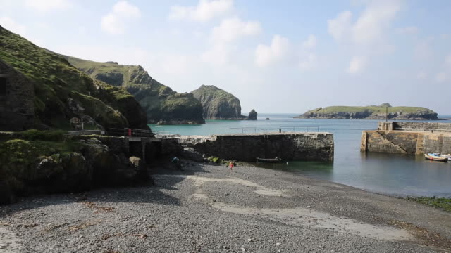 Mullion Cove harbour Cornwall UK The Lizard England UK PAN video