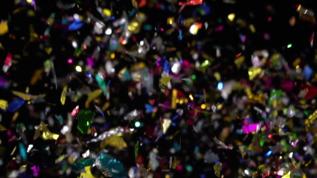 Multi colored Confetti explosion on black background