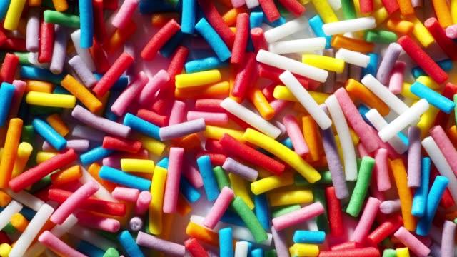 multi colored sprinkles - dolci video stock e b–roll