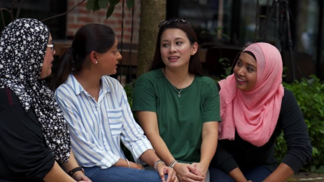 Multi ethnic friends having fun together Multi ethnic friends having fun together. Indian and malaysian ethnicities. religion stock videos & royalty-free footage