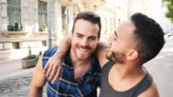istock Multi ethnic gay couple sharing romance in summer in the city 1160823575