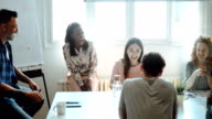 istock Multi ethnic group of creatives at an office in a meeting 1161990232