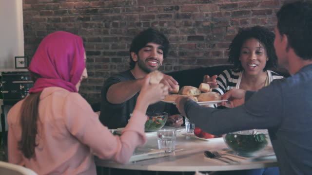 Multi Ethnic Group of Friends Enjoy Meal Together video
