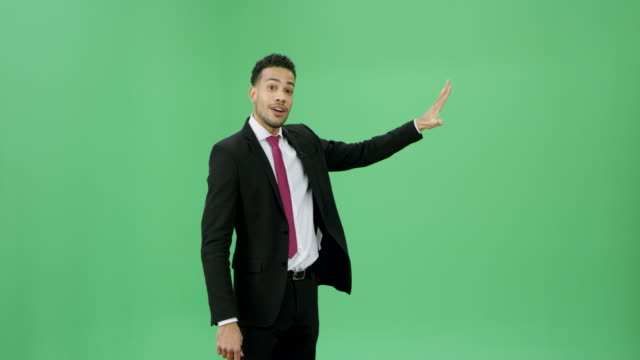 Multi ethnic man in a dark suit presenting weather news video