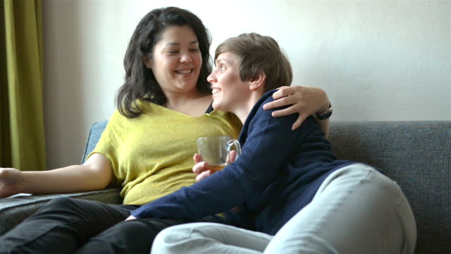 dolly: multi ethnic real life lesbian couple at home - same sex couples stock videos and b-roll footage