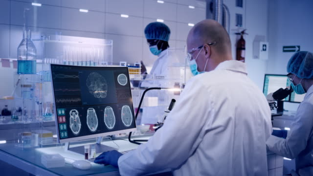 Multi ethnic research team studying brainwave scanning Scientists examines brainwave models in modern Neurological Research Laboratory. medical research stock videos & royalty-free footage