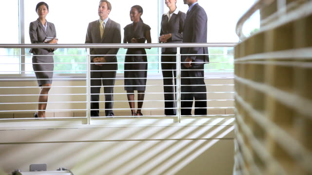 Multi ethnic team meeting on atrium video