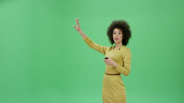 Multi ethnic woman with curly hair presenting the weather conditions and forecasts video