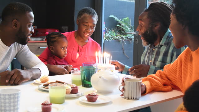 multi generation african family singing happy birthday with birthday cake - 50 59 lat filmów i materiałów b-roll