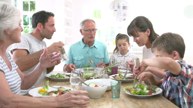 Multi Generation Family Eating Meal Around Kitchen Table video