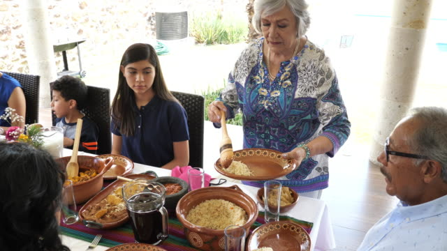 Multi generation Mexican family having lunch