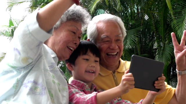 multi generation selfie hong kong - grandparents stock videos & royalty-free footage