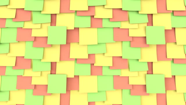 Multicolor post it stickers on the wall. Office work or reminder concepts. FullHD seamless loop close up dolly clip video