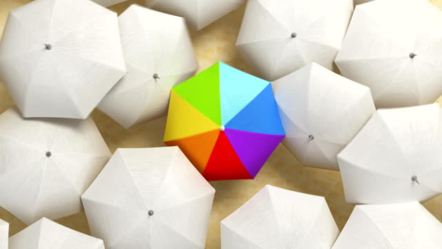 Multicolor Umbrella Wades Through a Flow of White Umbrellas