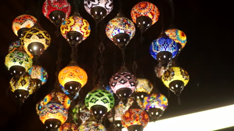 Multicolored Arabic mosaic glass lamps in the hotel. MS Dolly right Camera and selective focus with color grading. Use for background clip or insert shot of Multicolored Arabic mosaic glass lamps in the hotel. art and craft stock videos & royalty-free footage