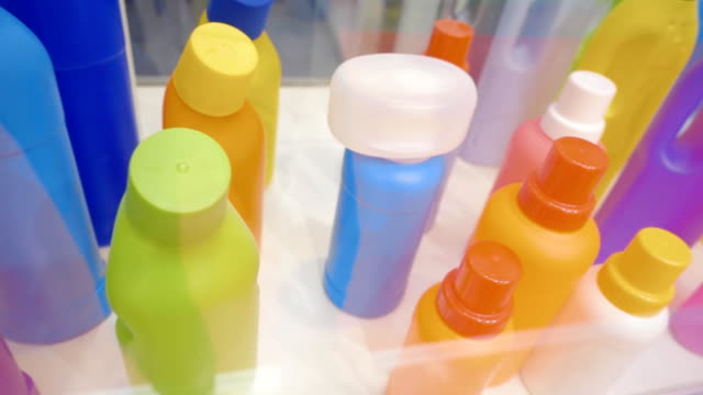 multicolored empty plastic bottles and containers for storing liquid products - lysol stock videos & royalty-free footage