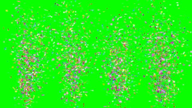 vídeos de stock e filmes b-roll de multicolored festive confetti explosions falling on a green background. - aniversário especial