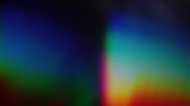vídeos de stock e filmes b-roll de multicolored iridescent bokeh for overlay effect. beautiful holographic foil. - prisma