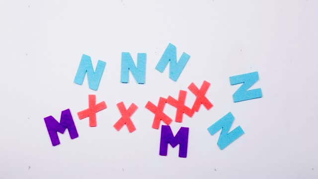 Multi-colored letters appear on a white background. Multi-colored letters appear on a white background. The letters M,N,X,Q Stop motion scandal abc stock videos & royalty-free footage