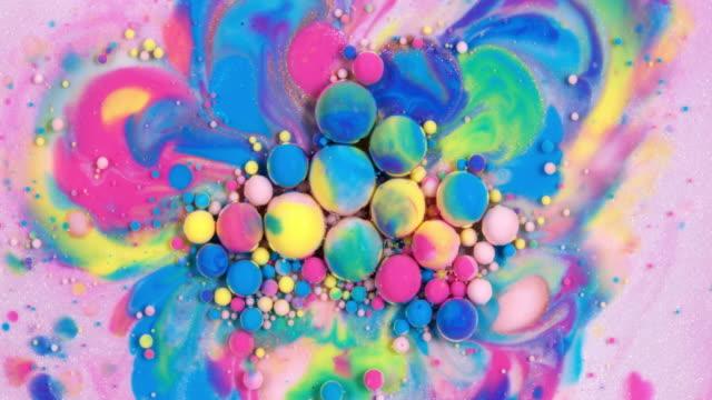 multicolored paint bubbles - tavolozza video stock e b–roll