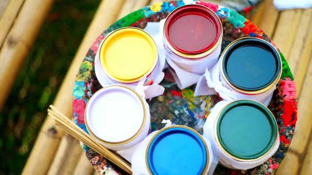 Multicolored paint bucket.