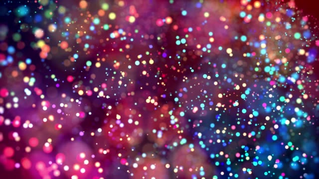 multicolored particles like confetti or spangles float in a viscous liquid and glitter in the light with depth of field. 3d abstract animation of particles in 4k. luma matte as the alpha channel. 33 video
