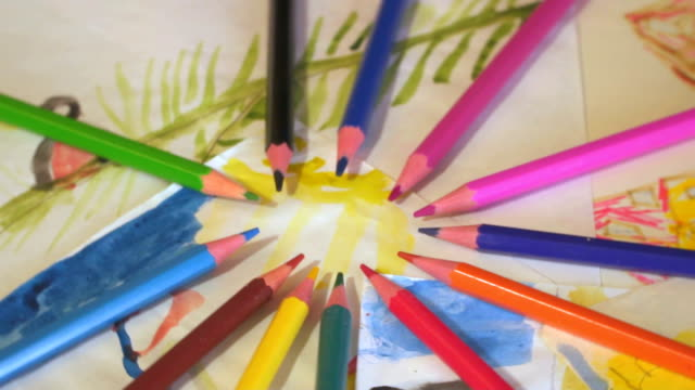 Multicolored pencils and children's drawings video