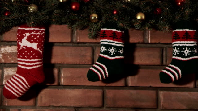 Multi-colored socks for Christmas gifts Multi-colored socks for Christmas gifts christmas stocking stock videos & royalty-free footage