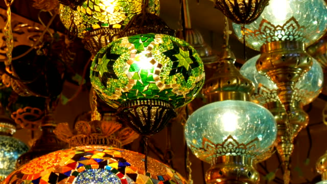 Multi-colored Turkish mosaic lamps on the ceiling market in the famous Grand Bazaar