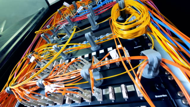 Multicolour cables connected to multiple servers