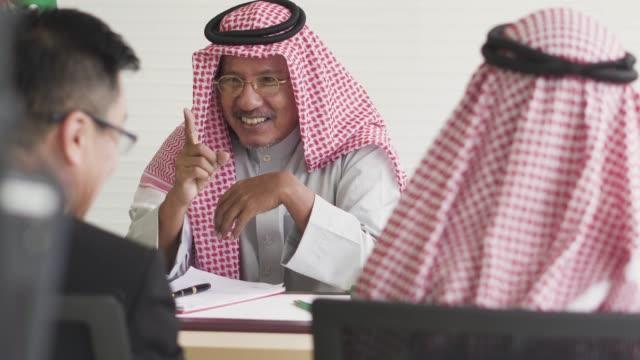 multicultural international oversea business meeting - arab стоковые видео и кадры b-roll