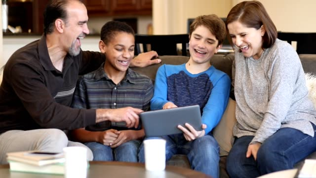 Multi-ethnic, adoption or foster care family at home. video