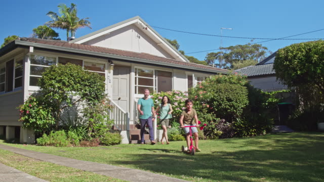 Multi-ethnic Australian parents and son leaving home for a walk at suburban Sydney video