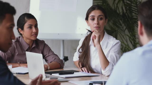 multiethnic business team brainstorm on project during corporate meeting - коллега стоковые видео и кадры b-roll