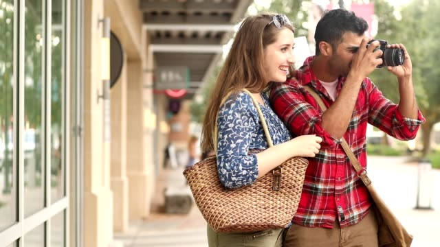 Multi-ethnic couple downtown city on vacation. video