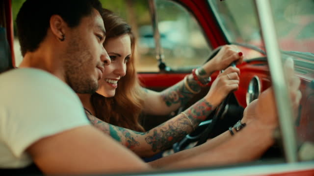 Multiethnic couple take a selfie in a vintage car video