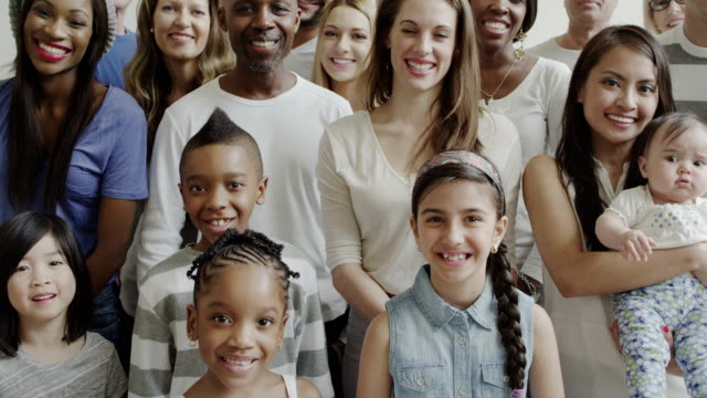Multiethnic diverse generation large group of people Crane up a large group of multi-ethnic children and adults. There is a variety of ages from small children to senior adults. Diverse ethnicities including black, african american, asian, hispanic, caucasian. Everyone is happy and smiling. group of people stock videos & royalty-free footage