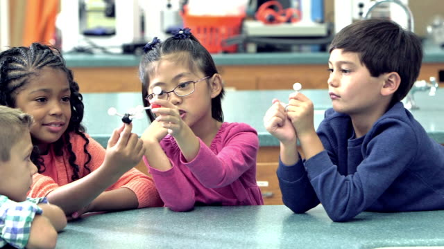 Multi-ethnic elementary school children in science class video